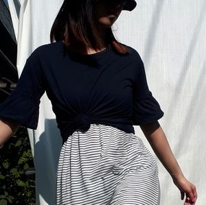 Black t-shirt with ruffled sleeves.